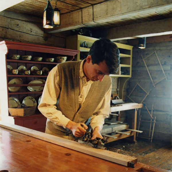 A museum interpreter demonstrating wood planing in 1991. Source: Civic Collection
