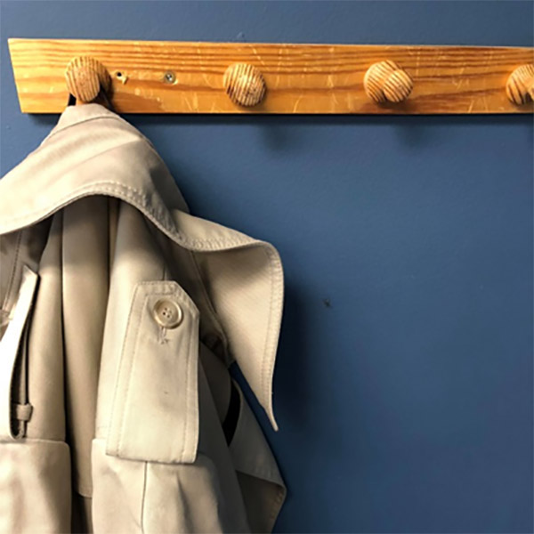 Sandy MacLachlan's trench coat hanging in the office at the museum