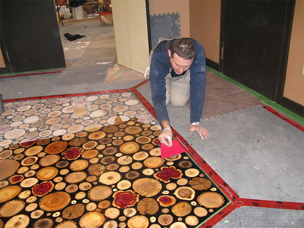 Premature degradation of the original wood floor required its replacement in 2009 using a different technique to achieve a similar effect