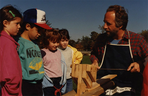 Students from Prince Edward School learn to use the shaving horse and drawknife, 1987